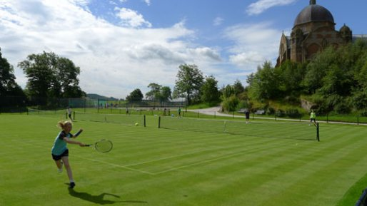 Girl tennis play on the grass courts of Yorkshire Tennis Camp